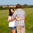 Young love couple smiling outdoor in summer — Stock Photo