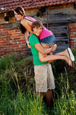Young couple in love having fun in summer outdoor — Stock Photo