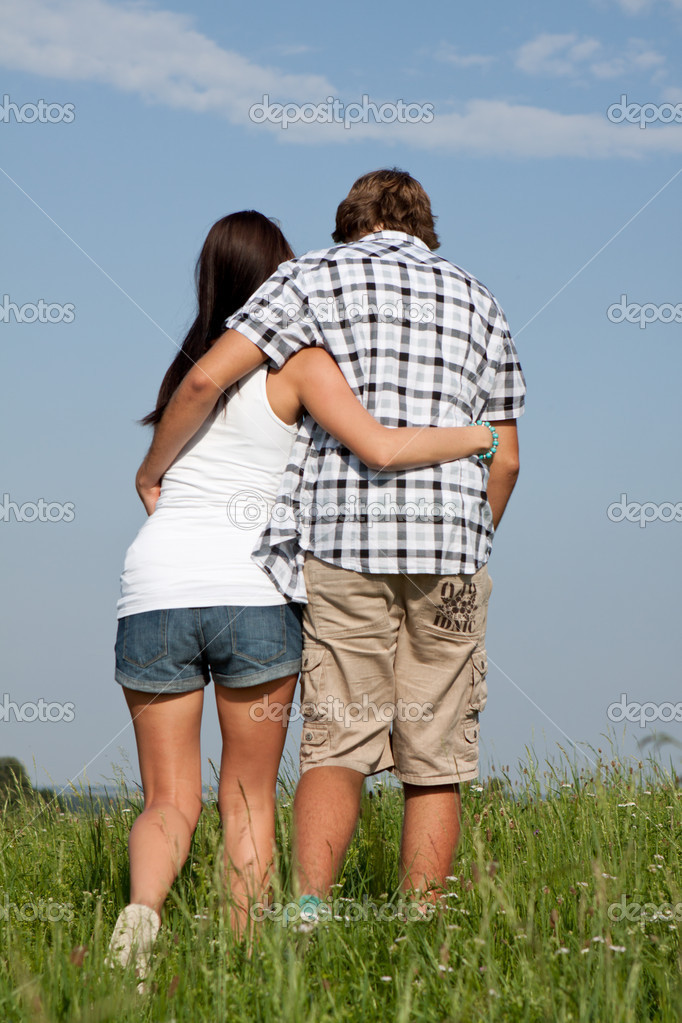Young love couple smiling outdoor in summer having fun — Stock Photo #12081365