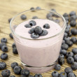 Fresh delicious blueberry yoghurt shake dessert on table - Stock Photo
