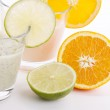 Fresh tasty lime and orange yoghurt shake cream isolated — Stock Photo #12265111