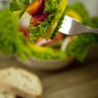 Fresh tasty healthy mixed salad and bread on table - Stock Photo