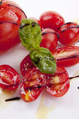 Fresh red tomatoes with balsamic and oilve oil isolated — Stock Photo