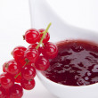 Tasty fresh red currant jam isolated on white — Stock Photo