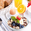Stock Photo: Deliscious healthy breakfast with flakes and fruits isolated