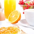 breakfast table with toast and orange marmelade isolated — Stock Photo