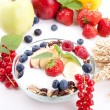 Deliscious healthy breakfast with flakes and fruits isolated - Stock Photo