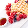 Sweet fresh tasty waffles with mixed fruits isolated — Stock Photo