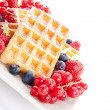 Sweet fresh tasty waffles with mixed fruits isolated - Stock Photo