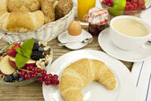Traditional french breakfast on table in morning — Stock Photo