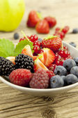 Fresh tasty berry collection on table in summer — Stock Photo