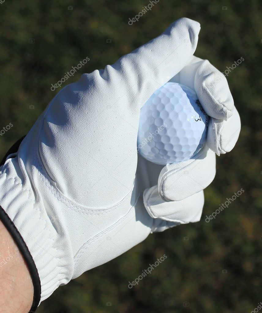 A golf ball in a golfers gloved hand — Stock Photo #11499535