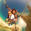 Paragliding at 0ludeniz, Turkey - Stock Photo