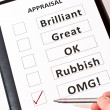 A fun perfomance appraisal form on black case - Stock Photo