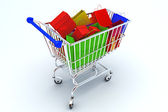 Courful bags in shopping cart — Stock Photo