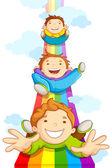 Kids SLiding on Rainbow — Stock Vector
