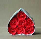 Red roses in a vintage box — Stock Photo