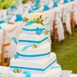Wedding cake and table setting outdoors - Stock Photo