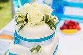 Detail of blue-white wedding cake — Stock Photo