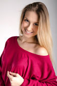 Smilling attractive girl in red pullover — Stock Photo