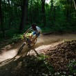 Man bikes in the forest — Stock Photo #11333386