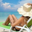 Woman relaxing on a beach — Stock Photo #11306788
