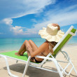 Stock Photo: Woman relaxing on a beach