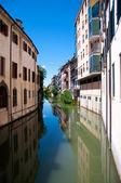 Water canal with reflections in Padova — Stock Photo