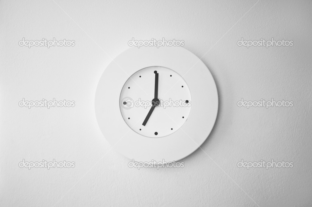 Contemporary minimalist white clock on a plastered white wall — Stock Photo #10946422