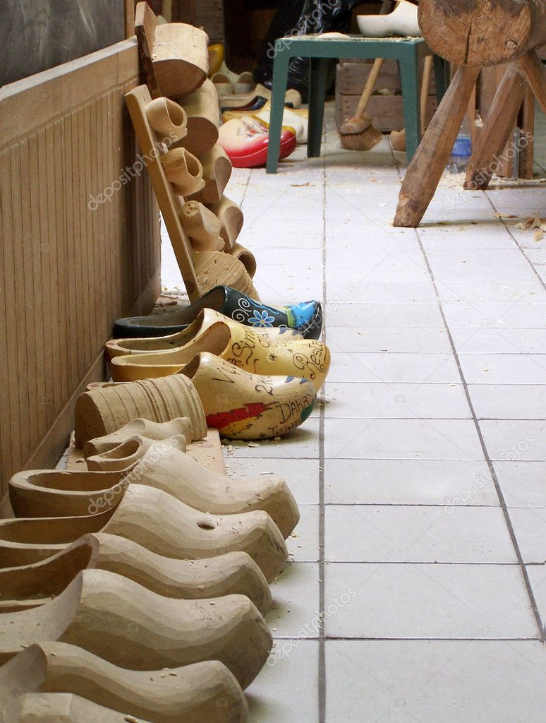 Roughly processed wooden footwear called clogs in special clogs workshop, Netherlands, Europe — Stock Photo #11140828