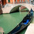 Venetian gondola at its mooring — Stock Photo