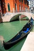 Venetian gondola at its mooring — Stock Photo