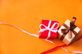 Gift boxes with satin ribbons and bows — Stock Photo