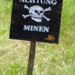 Inscription on a sign &amp;quot;Attention, mines!&amp;quot; in German - Stock Photo