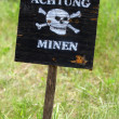 "Inscription on a sign ""Attention, mines!"" in German - Stock Photo"