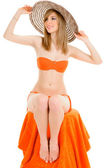 Young woman in orange bikini — Stock Photo