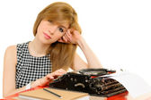 Elegant woman working on typewriter — Stock Photo