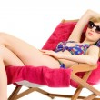 Young woman relaxing on beach chair — Stock Photo