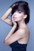 Fashion style portrait of delicate brunette woman — Stock Photo