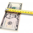 Money and measuring roulette. On a white background. - Stock Photo