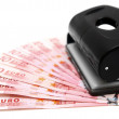 Foto de Stock  : To perforate money. On white background.
