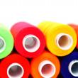 Multi-coloured threads on white background. — Stock Photo #10783758