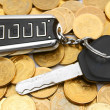 Royalty-Free Stock Photo: Coins and a key from the car.
