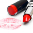 Lipstick and trace from a kiss. On a white background. — Stock Photo