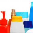 Multi-coloured bottles. On a white background. - Stock Photo