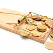 Mousetrap and gold coins. On a white background. — Stock Photo