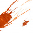 Splashes of a brown paint on a white background. - Stock Photo