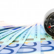 Money and compass. On a white background. - Stock Photo