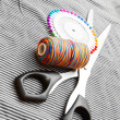 Threads, scissors and needles on a fabric. — Stock Photo #10789761