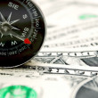 Compass and money. — Stock Photo